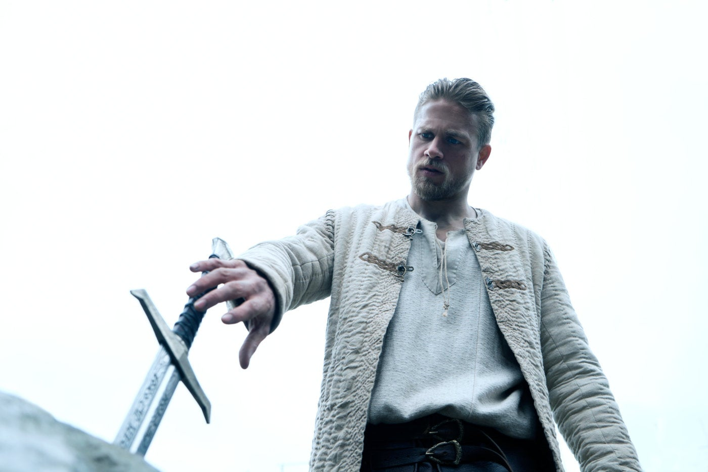 """Charlie Hunman in a scene from """"King Arthur: Legend of the Sword"""""""