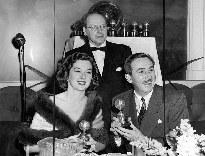 Rosalind Russell (Best Actress for Mourning Becomes Electra) and Walt Disney (Special Award for Bambi), with HFCA President Fredrick Porges, at the 5th Annual Golden Globe Awards, held March 10, 1948 at the Hollywood Roosevelt Hotel.
