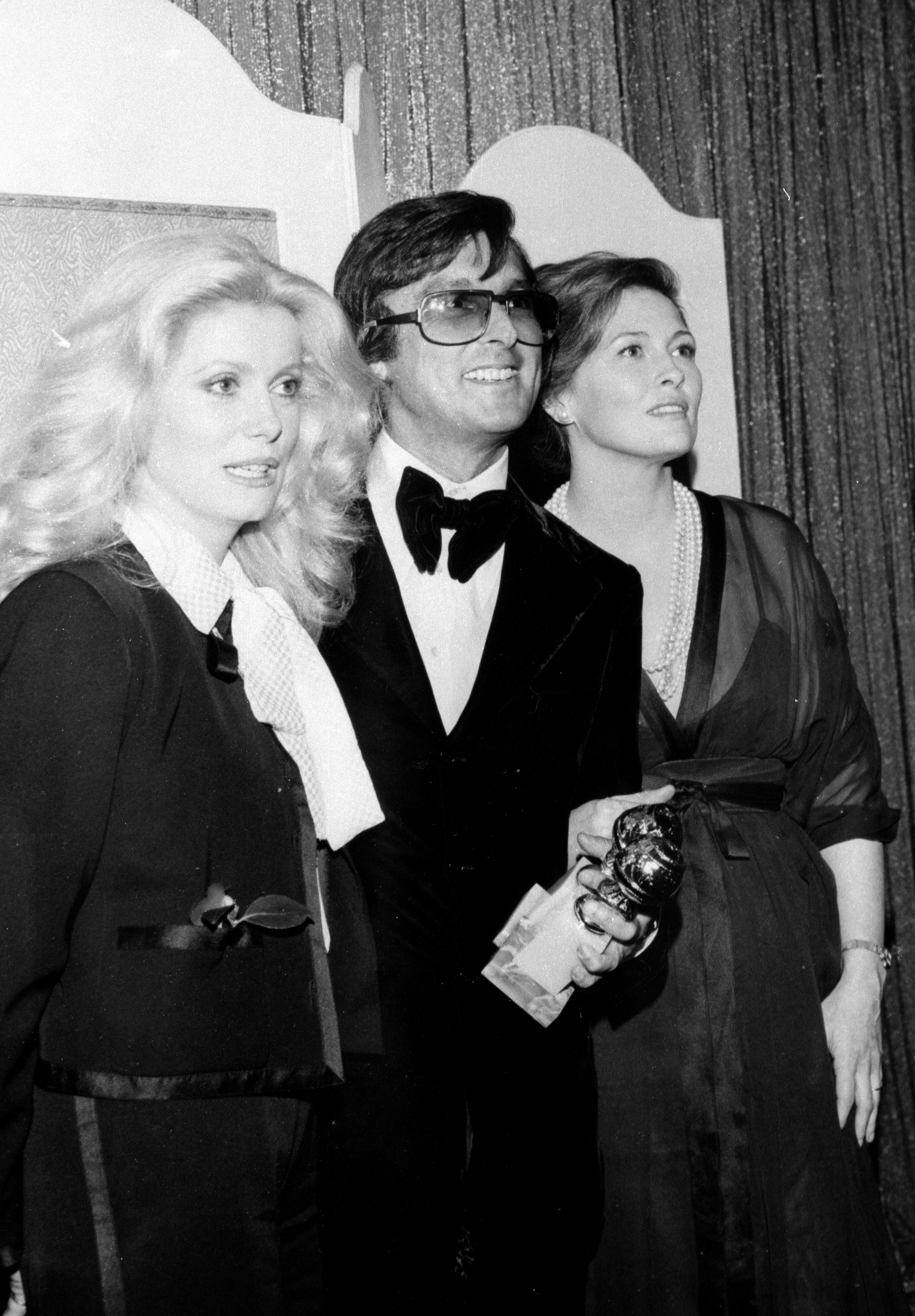 Robert Evans, Catherine Deneuve and Faye Dunaway at the 1975 Golden Globes
