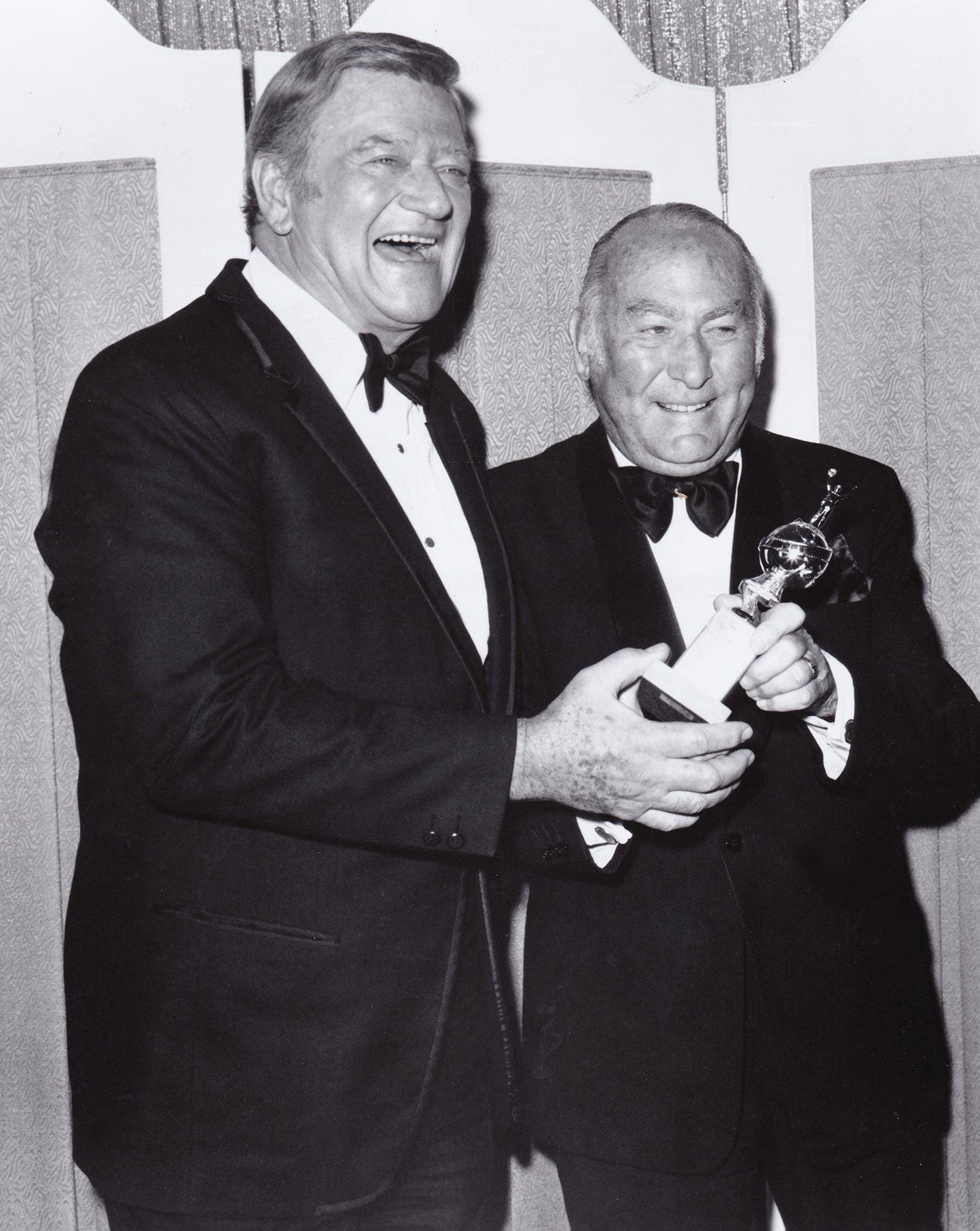 John Wayne presents Cecil B. deMille award to Hal B. Wallis, 1975