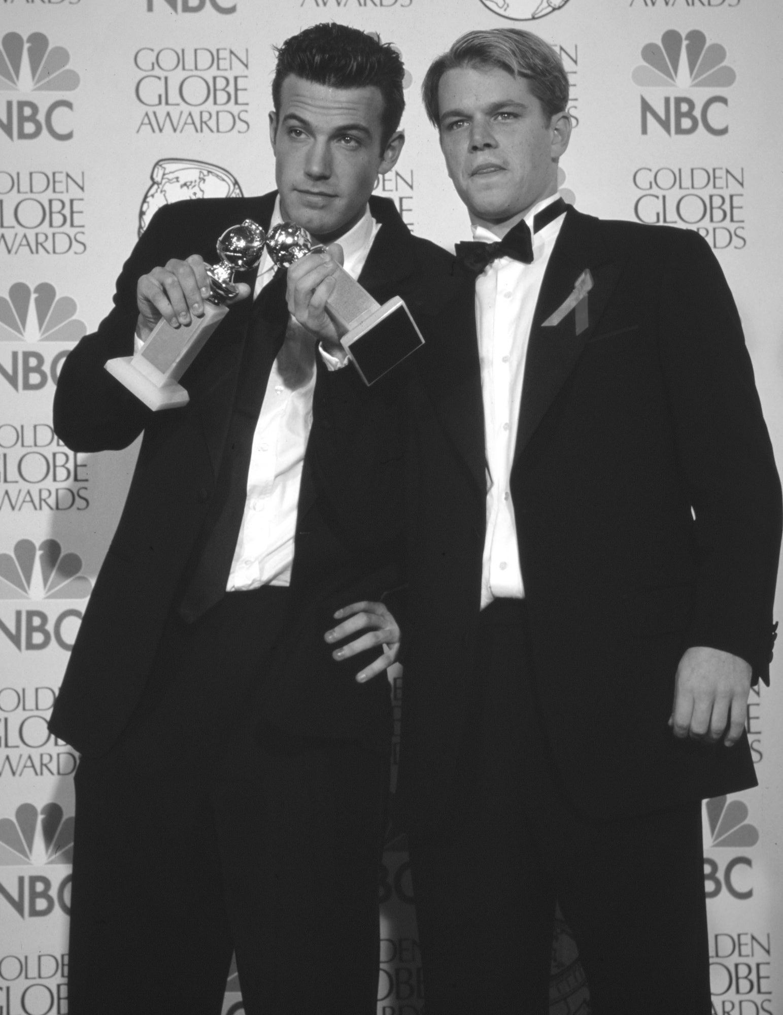 Actor Matt Damon, Golden Globe winner, and Ben Affleck wit thier Golden Globe for the screnplay of Good Will Hunting, 1998