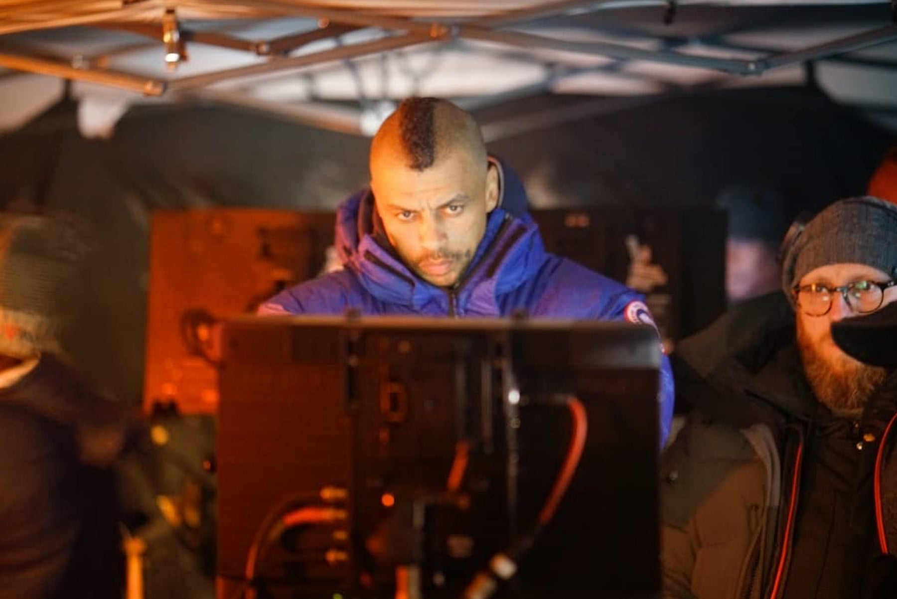"Mark Tonderai at the monitor while shooting ""The Passage"" (2019)"