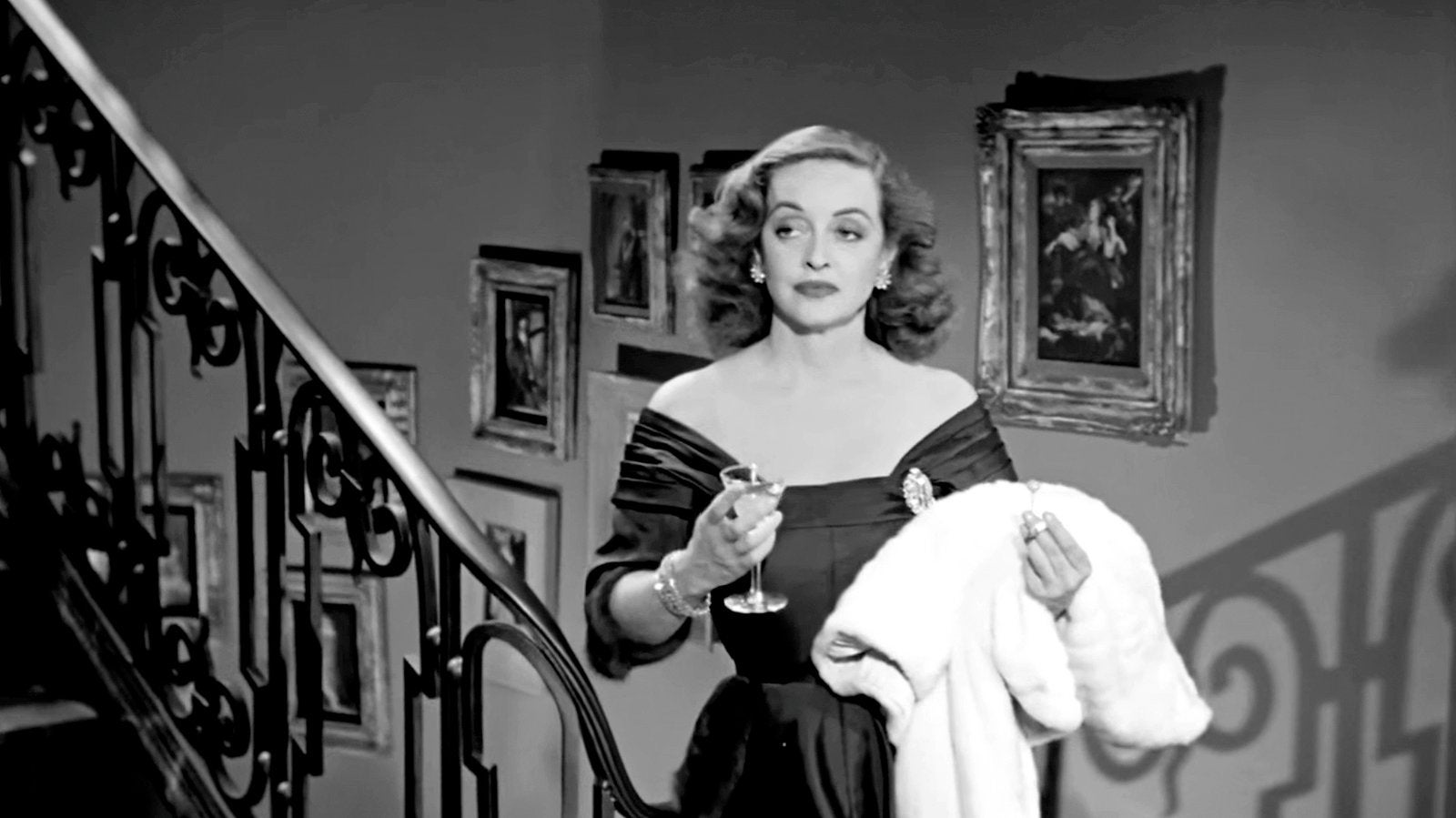 Acress Bette Davis, Cecil B. deMille recipient in a scene from All About Eve, 1950