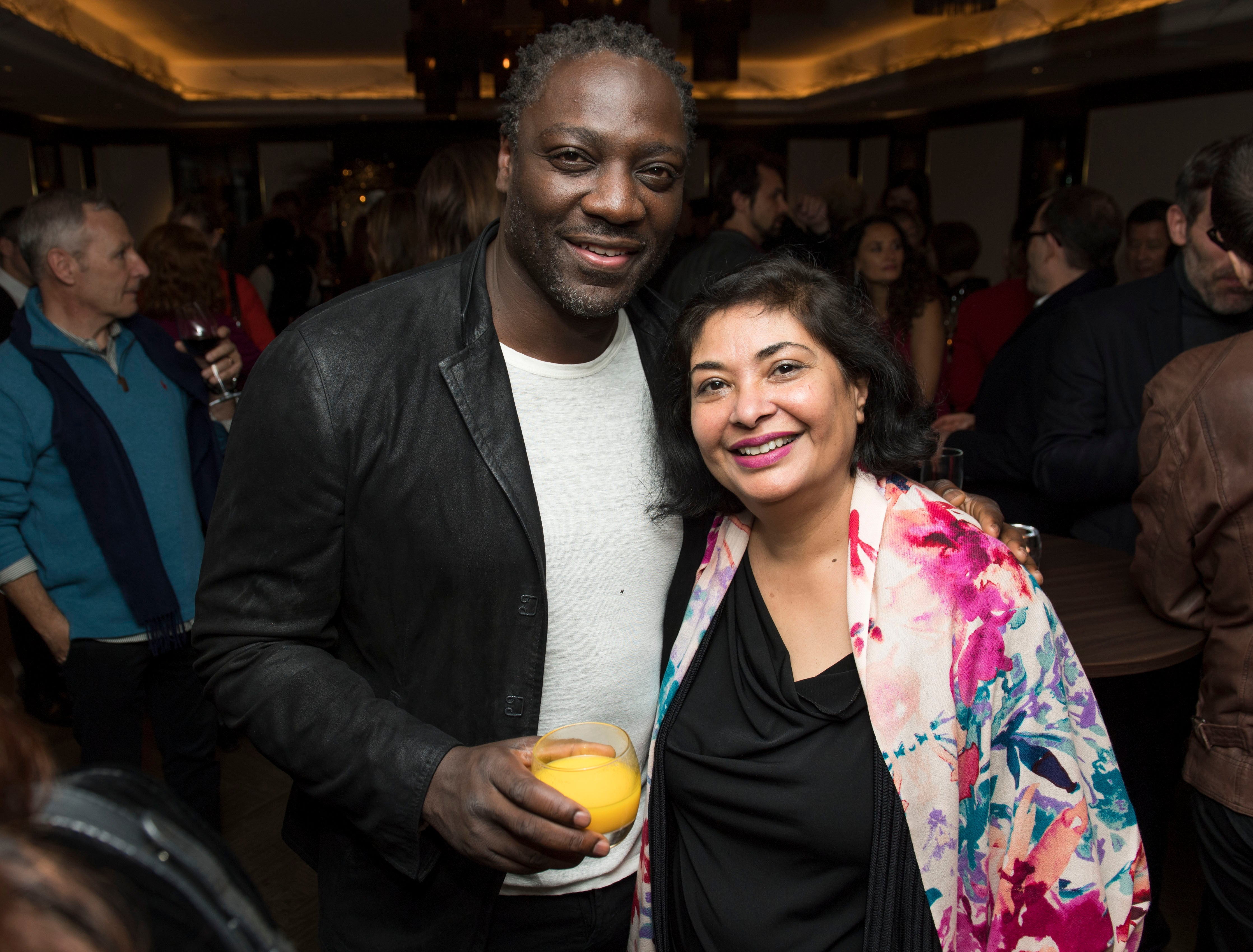 HFPA President Meher Tatna and actor Adewale Akinnuoye-Agbaje,  at the London Golden Globes Reception