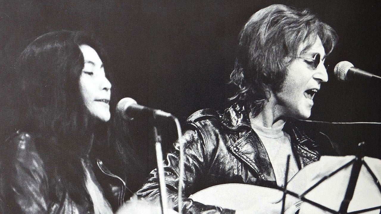 "John lennon and Yoko Ono ina scene from ""Above Us Only Sky"", 2018"