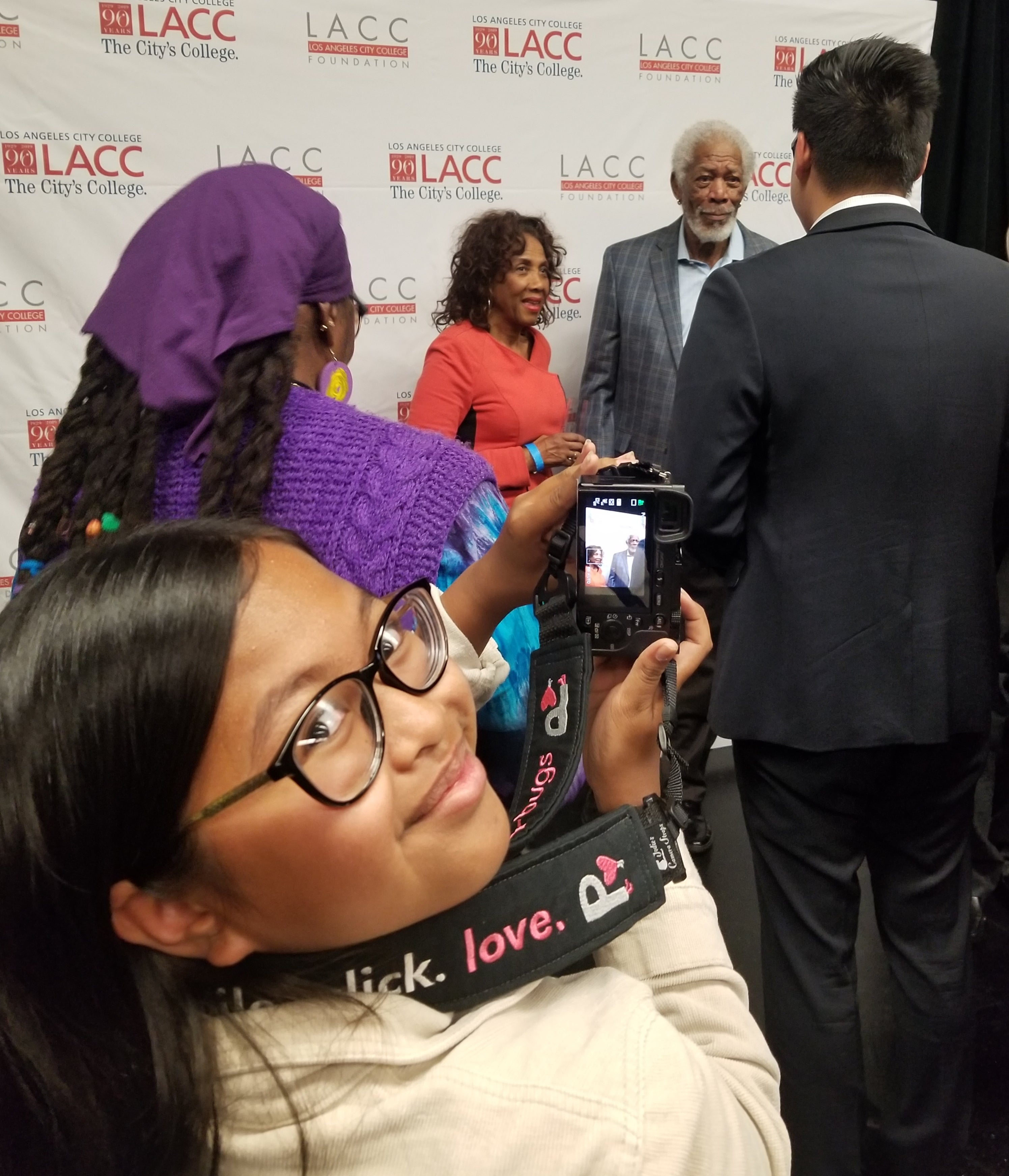 Francine Gascon phptographing Morgan Freeman at the LACC inauguration