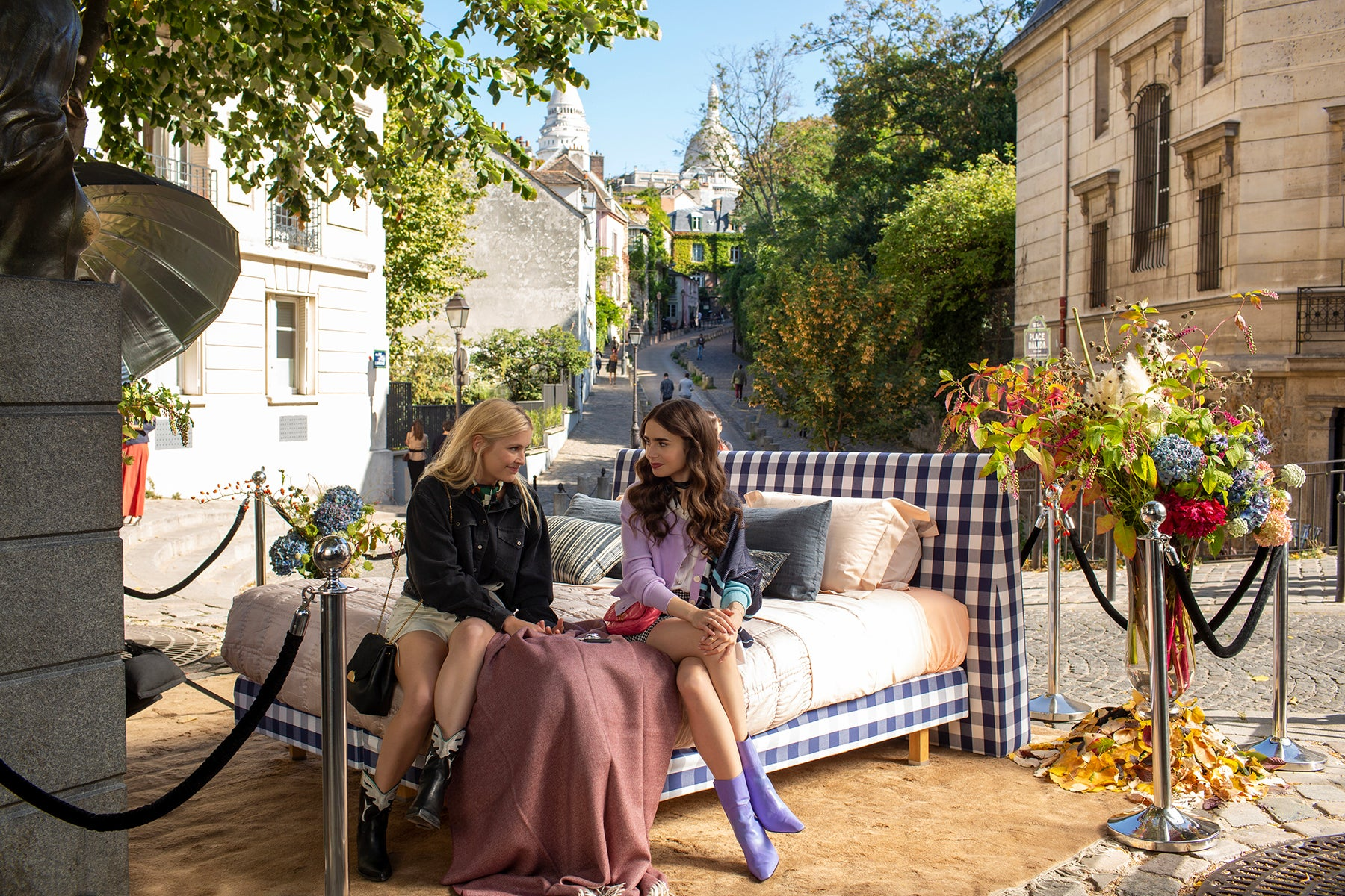 """Camille Razat and Lily Collins in """"Emily in Paris"""" (2020)."""