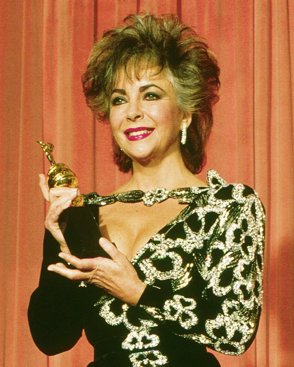 Eizabeth Taylor with her Cecil B. de Mille Award. 1985