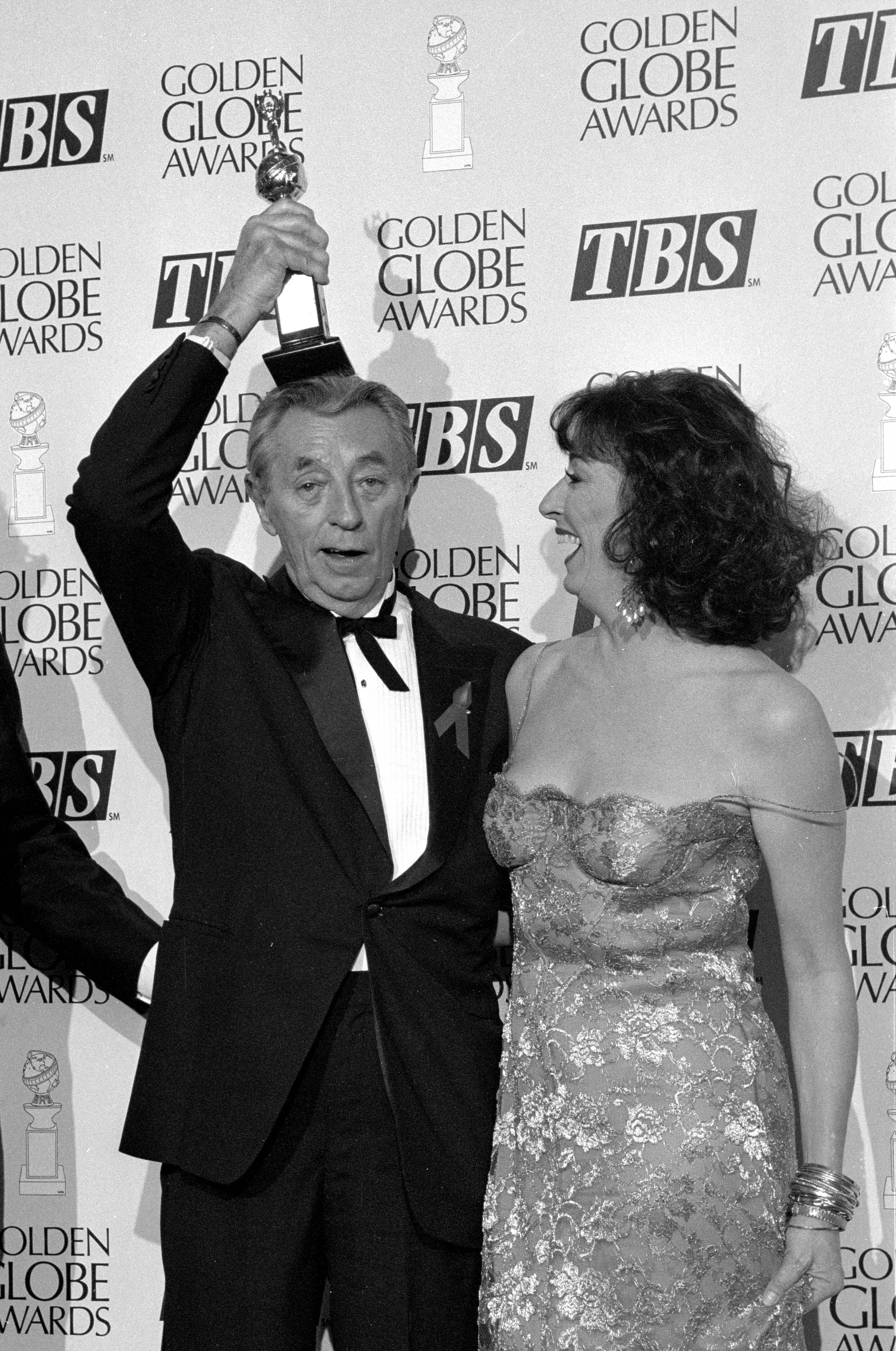 Robert Mitchum and Anelica Huston backsatge at the Golden Globes, 1992