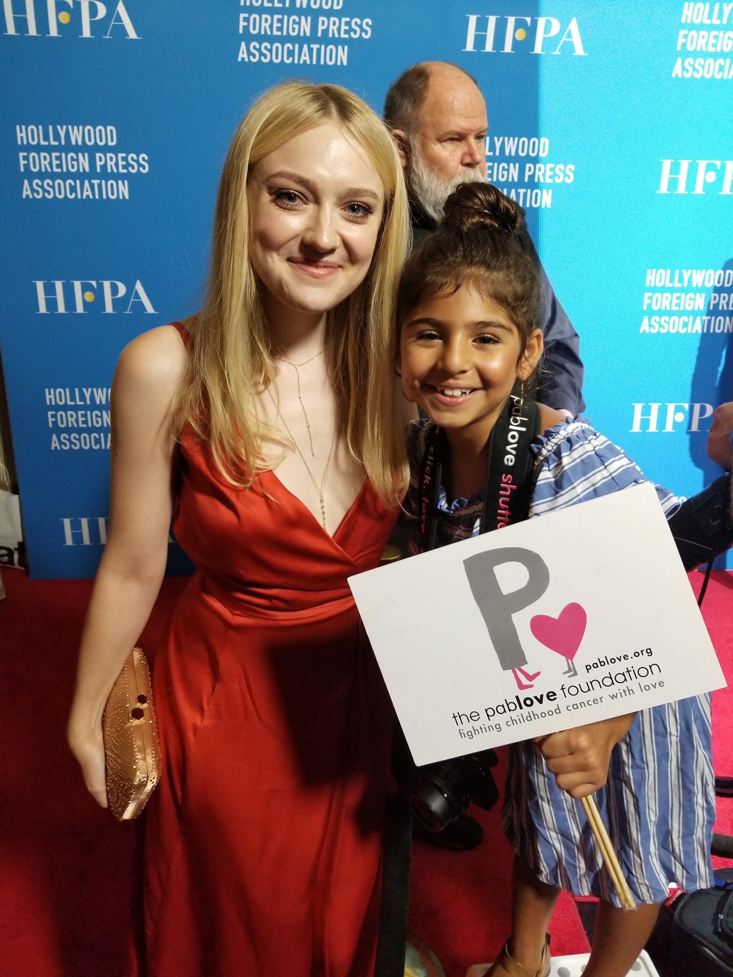 Yasmine, a Pablolove Shutterbug, at the HFPA Grants Banquet 2018, wit Dakota Fanning