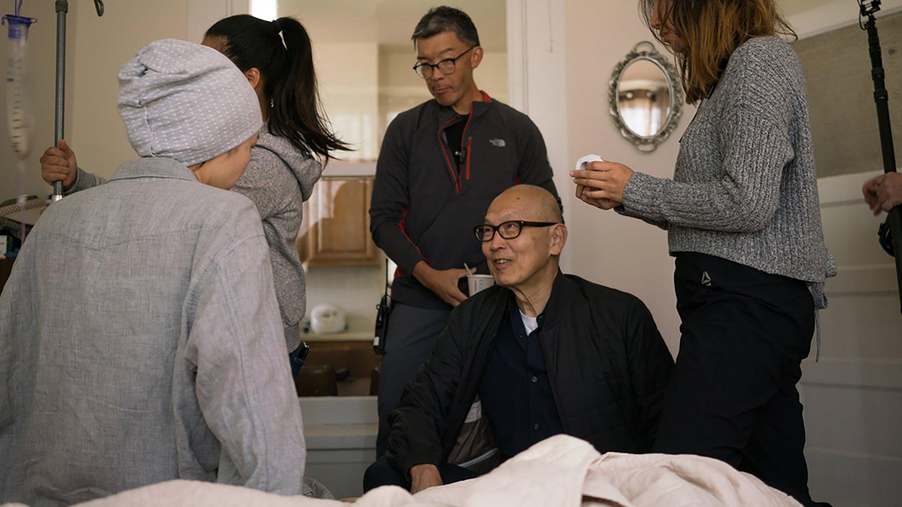 "Wayne Wang on the set of ""Coming Home Again"" (2019)"