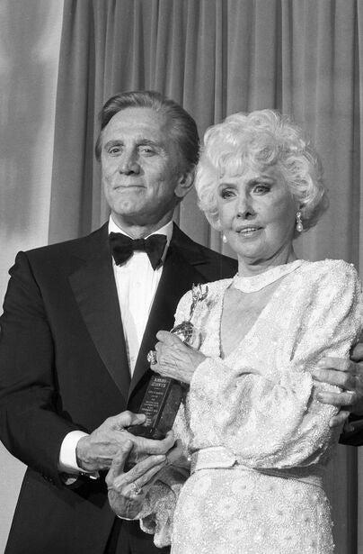 Actress Barbara Stanwyck, Golden Globe winner, Cecil  B. deMille Award recipient, with Kirk Douglas, 1986
