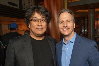 Filmmaker Bong Joon Ho and Neon president Tom Quinn, 2019