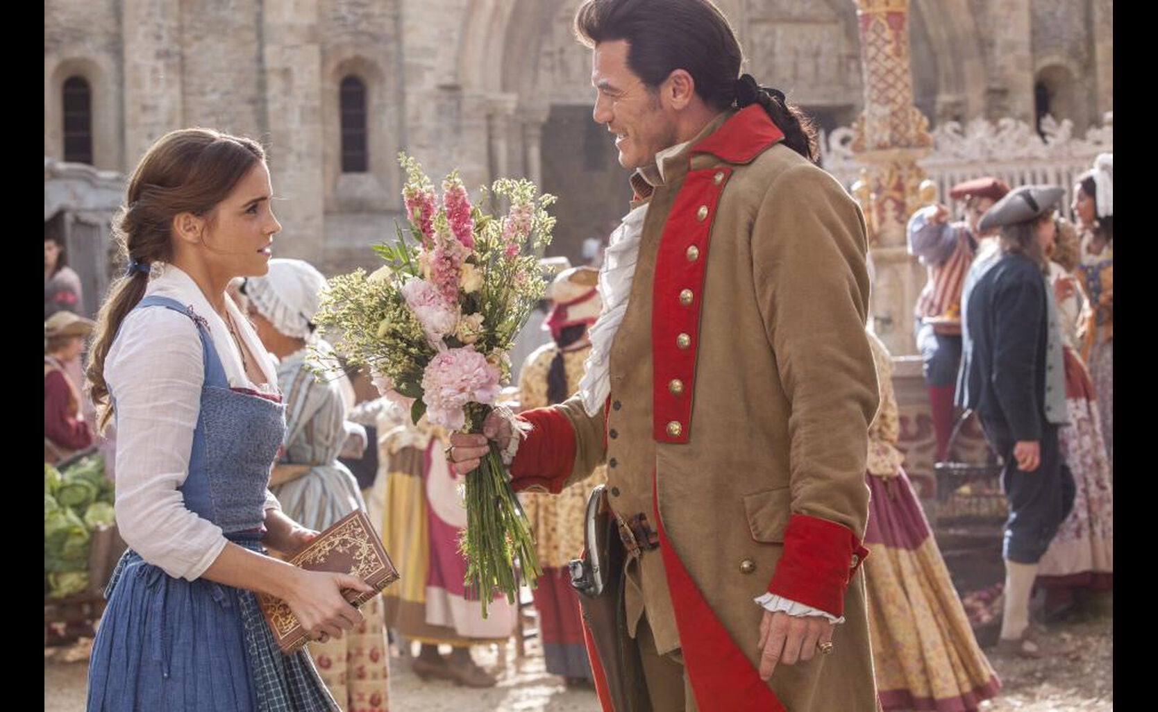 "Belle (Emma Watson) and Gaston (Luke Evans) in ""Beauty and the Beast"""