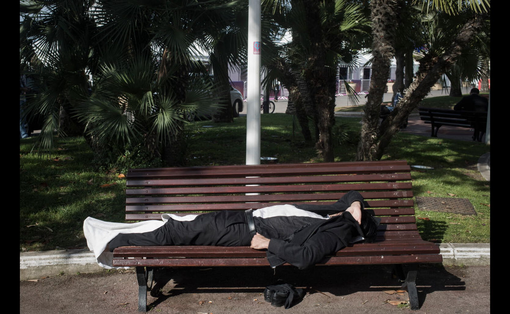 A man resting on bench at Cannes, France