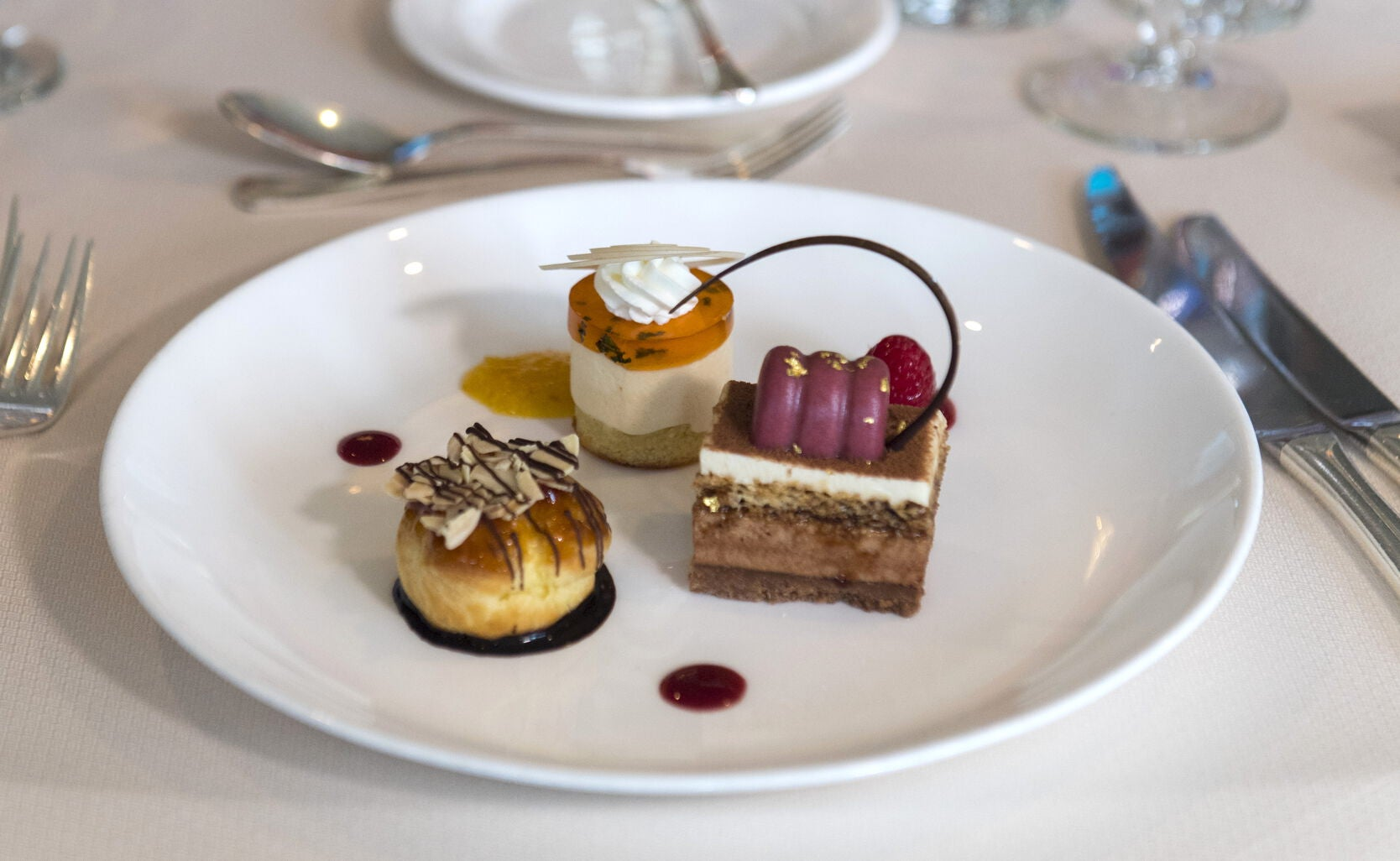 Creating the show-stopping dessert for his seventh consecutive year, Henzi prepared a trio including Neapolitan almond cake with orange mascarpone, profiteroles filled with amaretto vanilla cream, and chocolate gianduja crunch bars.