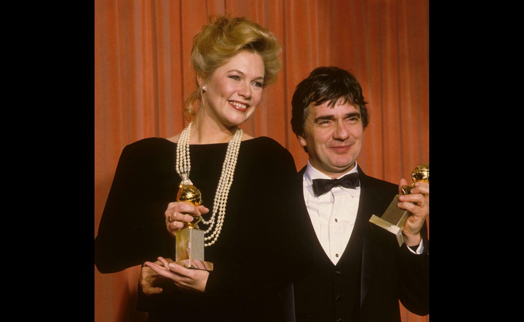 Kathleen Turner, Dudley Moore, 1985