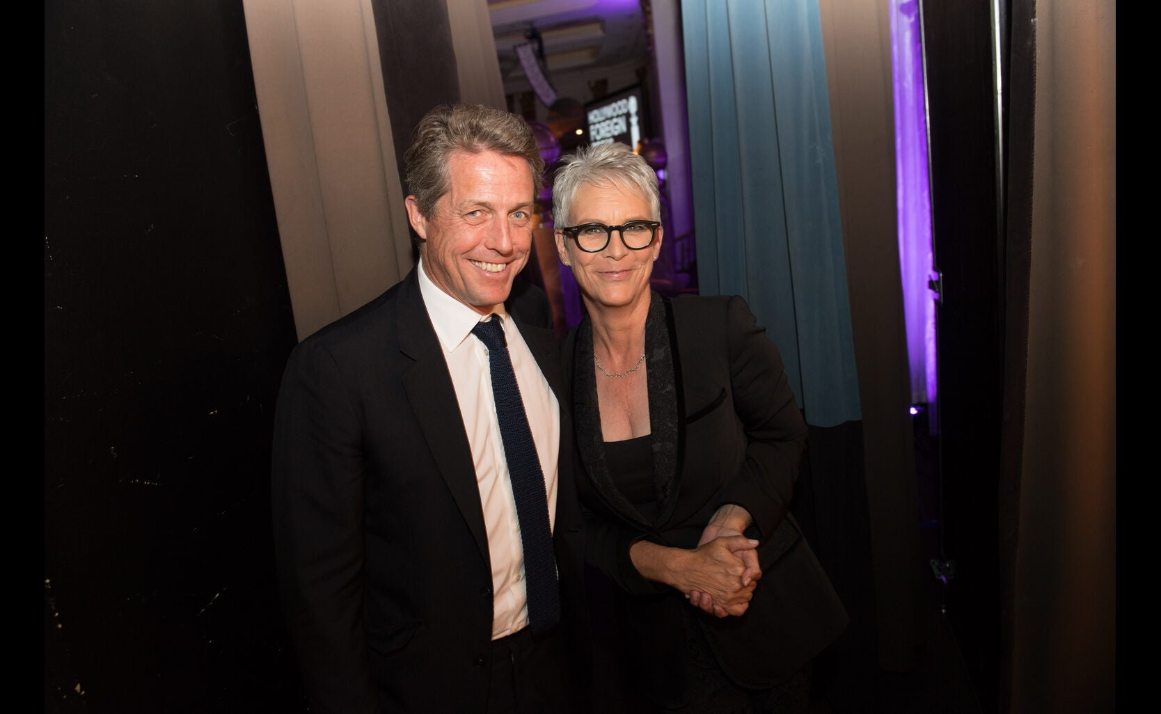 Jamie Lee Curtis and Hugh Grant at the HFPA Grants Banquet 2016