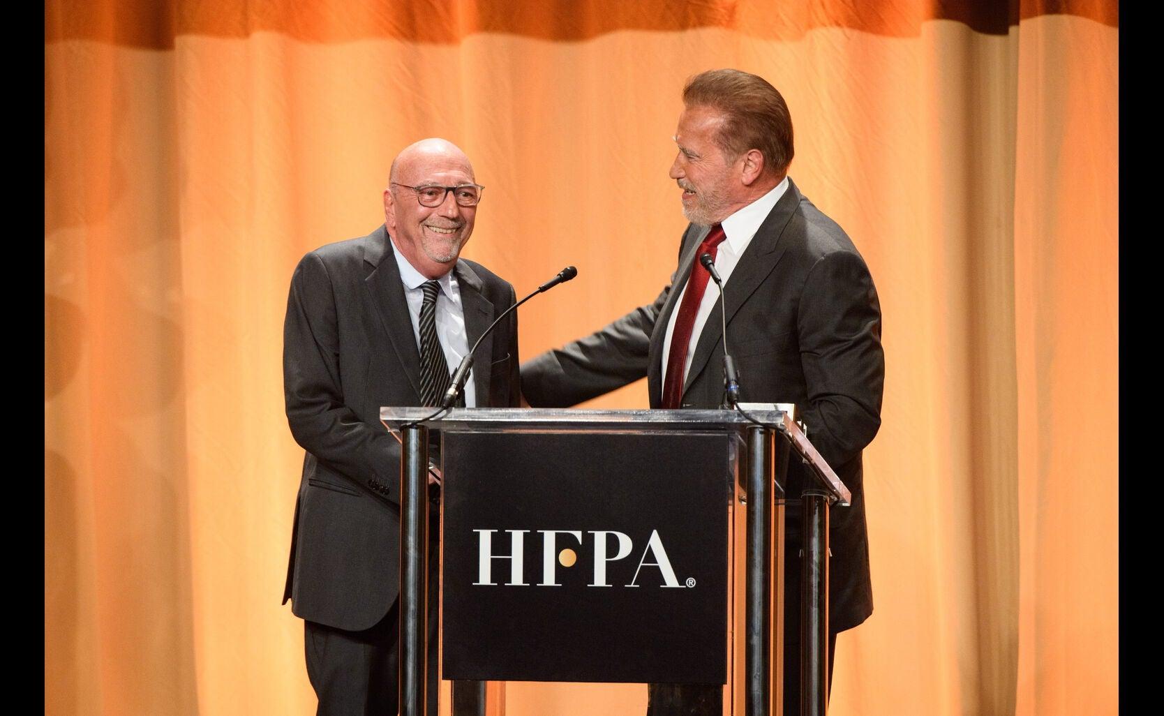 HFPA president Lorenzo Soria and actor Arnold Schwarzenegger, Golden Globe winner