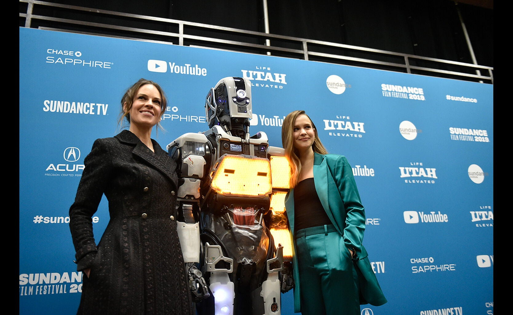 Hillary Swank and the robot Mother.