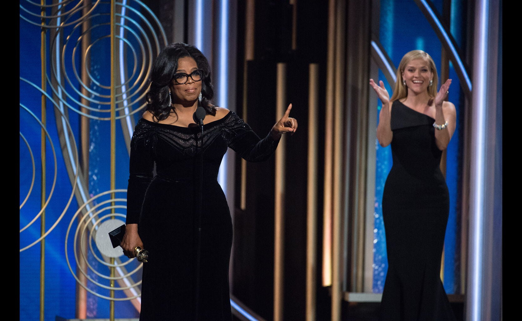 Oprah Winfrey, recipient of the Cecil B. deMille Award, and Reese Witherspoon