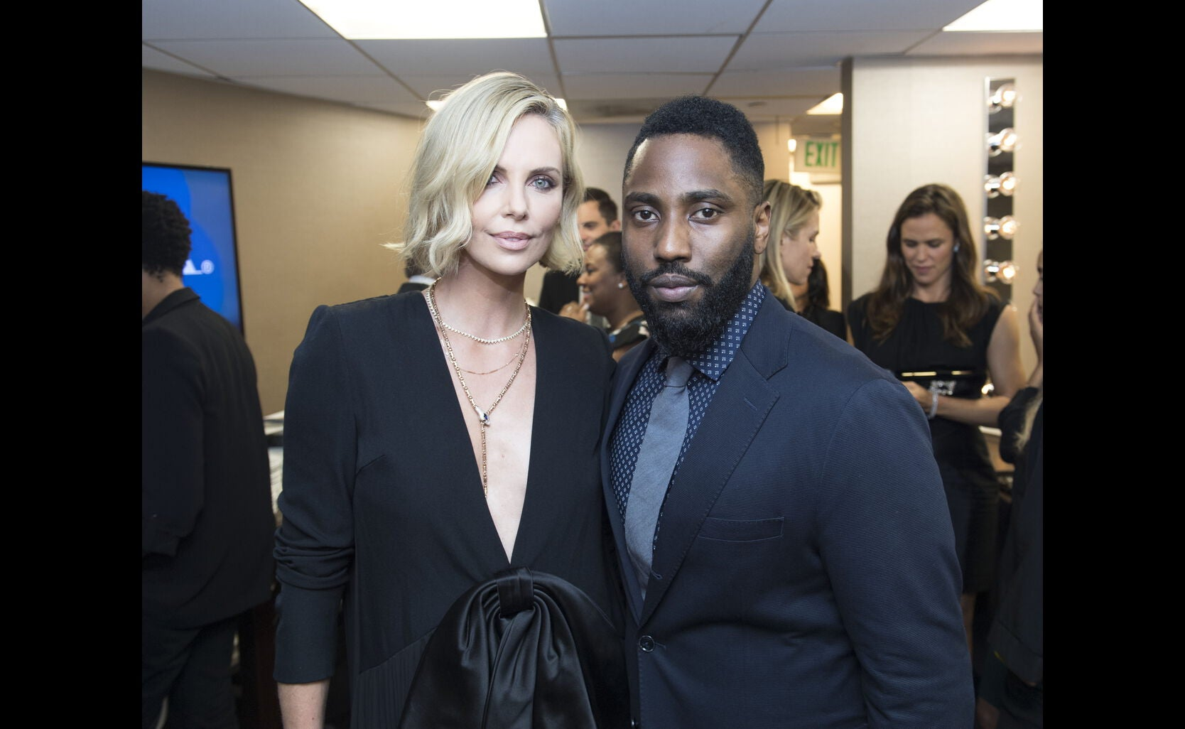Charlize Theron and John David Washington