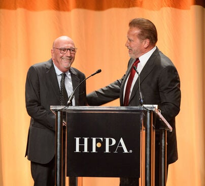 HFPA presidnet Lorenzo Soria and actor Arnold Schwarzenegger, Golden Globe winner