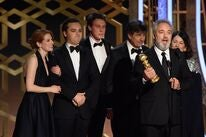 Filmmakers and cast of 1917 on stage at the 77th Golden Globes