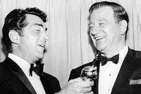 Dean Martin presents the Cecil B. deMille to John Wayne, 1966