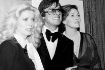 Robert Evans, Catherine Deneuve and Faye Dunaway at the 1975 Golden Globes