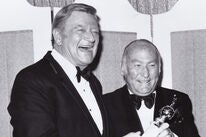John Wayne presents Cecil B. deMille award to Hal B. Wallis, 1975