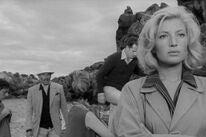 """James Addams, Gabriele Ferzetti, Lelio Luttazzi, and Monica Vitti in """"L'avventura"""" (1960)"""