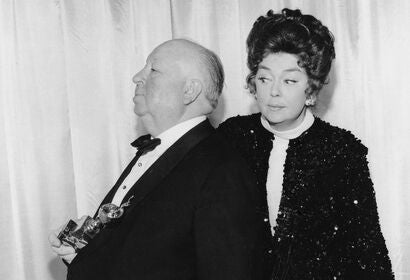 Alfred Hitchcock and Rosalind Russell