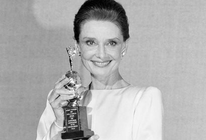 Audrey Hepburn, Golden Globe winner, and her Cecil B. deMille award, 1990