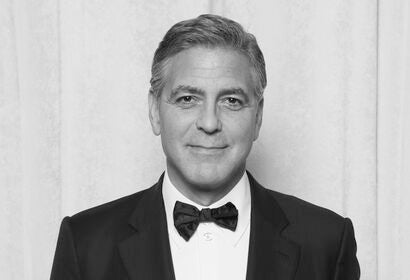 George Clooney with his 2015 Cecil B. deMille Award