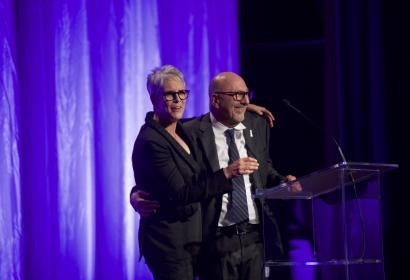 Host Jamie Lee Curtis and HFPA President Lorenzo Soria