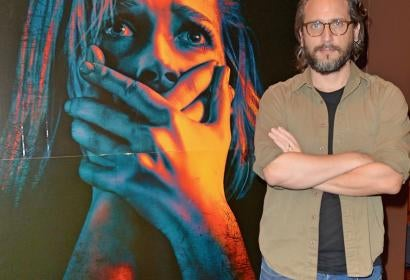 Director Fede Alvarez and a poster of his movie Don't Breathe