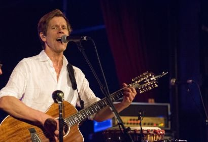 Actor Kevin Bacon, Golden Globe winner, performing on stage with his band The Bacon Brothers
