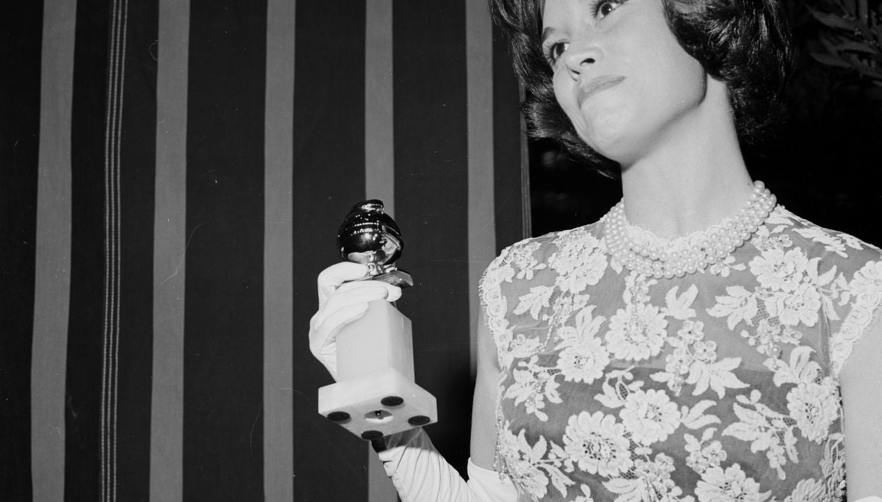 Actress Mary Tyler Moore receives her fisrt Golden Globe, 1965
