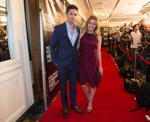 Beverly Hills, CA. August 13, 2015 Hollywood Foreign Press Association presents annual Grants Dinner Thursday night from the Beverly Wilshire Hotel.  The HFPA will present more than $2 million in donations to non-profit entertainment-related organizations and scholarship programs.  Pictured:  Topher Grace and Ashley Hinshaw arrive on the red carpet.